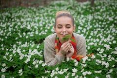 Beautiful sensual lady lying on flower meadow Stock Image