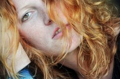 Beautiful sensual portrait in closeup of a thoughtful young redhead wistful stock photos