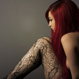 Beautiful sensual sad woman with long red hair. Stock Images