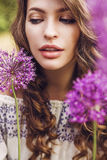 Beautiful sensual woman among big purple flowers. Spring, summer, beauty, healthcare. Beautiful sensual woman among big purple flowers royalty free stock image