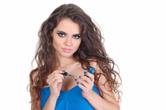 Beautiful sensual Woman in blue dress paint nails Stock Image