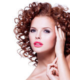 Beautiful sensual woman with brunette curly hair. Stock Image