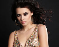 Beautiful sensual woman with dark hair with bijou in luxurious dress Royalty Free Stock Photography