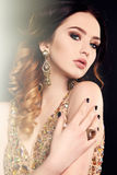Beautiful sensual woman with dark hair and bright makeup, with bijou Royalty Free Stock Photo