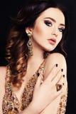 Beautiful sensual woman with dark hair and bright makeup, with bijou Stock Photo