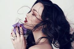 Beautiful sensual woman with dark hair and bright makeup Stock Image