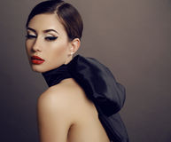 Beautiful sensual woman with dark hair and bright makeup, Stock Image