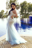 Beautiful sensual woman with dark hair in luxurious sequin dress. Fashion outdoor photo of beautiful sensual woman with dark hair in luxurious sequin dress royalty free stock photo