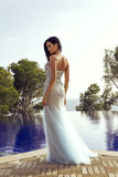 Beautiful sensual woman with dark hair in luxurious sequin dress Stock Image