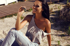 beautiful sensual woman with dark hair wearing casual clothes with sunglasses Stock Photo