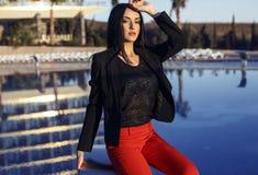 Beautiful sensual woman with dark hair wearing elegant suit Stock Images