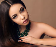 Beautiful sensual woman with dark straight hair with bright makeup Royalty Free Stock Photo
