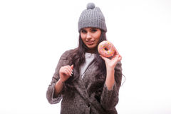 Beautiful sensual woman with a donuts in hand Royalty Free Stock Photos