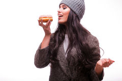 Beautiful sensual woman eat  a donut Royalty Free Stock Images