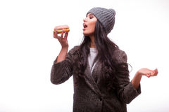 Beautiful sensual woman eat  a donut Stock Image