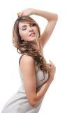 A beautiful sensual woman in a grey dress Stock Image