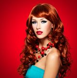 Beautiful sensual woman with long red hairs stock photography