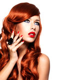 Beautiful sensual woman with long red hairs. stock photography