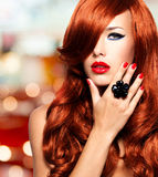 Beautiful sensual woman with long red hairs. Stock Images