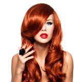 Beautiful sensual woman with long red hairs. stock image