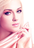 Beautiful sensual woman with pink silk. Royalty Free Stock Photography