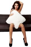 Beautiful sensual woman sitting on a sofa Stock Image