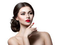 Beautiful sensual woman touching her face. Beauty and skincare concept. Isolated over white. Stock Images