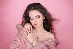 Beautiful sensual woman wearing a fur coat Stock Images