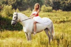 Beautiful sensual women riding on white horse Royalty Free Stock Image
