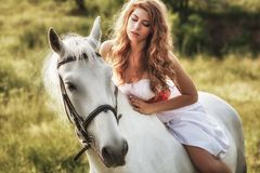 Beautiful sensual women riding on white horse Royalty Free Stock Photography