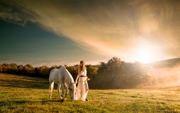 Beautiful sensual women with white horse royalty free stock photo