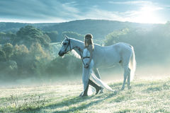 Beautiful sensual women with white horse Stock Image
