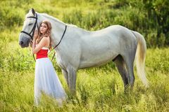 Beautiful sensual women with white horse Royalty Free Stock Images