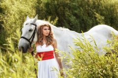 Beautiful sensual women with white horse Royalty Free Stock Photography