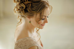 Beautiful sensual young blond woman smiling and looking down.Por Stock Photography