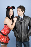 Beautiful sensual  young couple. Beautiful young couple posing ,the woman wearing a sexy mouse costume and the man a leather jacket,check also Couples Stock Image
