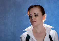 Beautiful sensual young woman in men`s shirt and tie on a blue background Stock Photography
