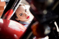 Beautiful sensual young woman with red lips looking at camera Royalty Free Stock Photo