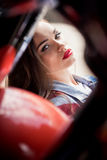 Beautiful sensual young woman with red lips looking at camera Royalty Free Stock Image