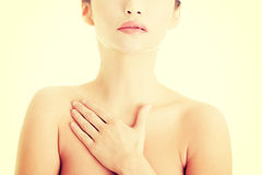 Beautiful sensual young woman touching her chest Stock Images