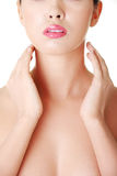 Beautiful sensual young woman touching her neck Royalty Free Stock Photos