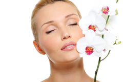 Beautiful serene female face with flowers Stock Image