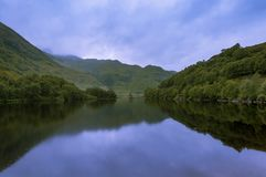 Beautiful and serene landscape of a lake and mountains in the Highlands of Scotland, United Kingdom Royalty Free Stock Photography