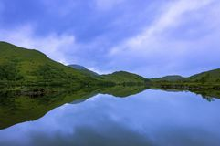 Beautiful and serene landscape of a lake and mountains in the Highlands of Scotland, United Kingdom Stock Photos
