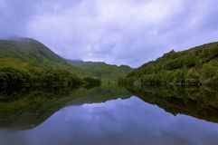 Beautiful and serene landscape of a lake and mountains in the Highlands of Scotland, United Kingdom Stock Images