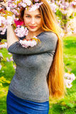 Beautiful serene woman and flower blossoms. Beautiful serene woman and pink flower blossoms Royalty Free Stock Photography