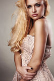 Beautiful serious blond woman Stock Photos