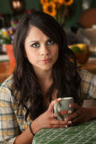 Beautiful Serious Latina Woman with Cofee or Tea Royalty Free Stock Photo