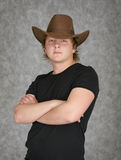 Beautiful serious young man in cowboy hat Stock Photos