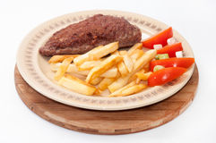 Beautiful served stuffed burger with fries Royalty Free Stock Photos